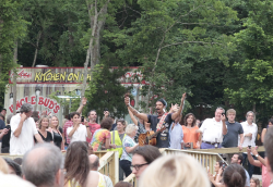 Michael Franti Performing in the Crowd