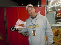 "Tom enjoying a Chicken on a Stick from ""The Best Around"" Concessions"